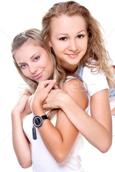 Twee mooie vrouwen witte geïsoleerd portret Stockfoto © Lupen