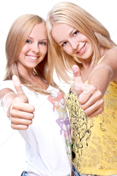 two beautiful women giving thumbs-up Stock photo © Lupen
