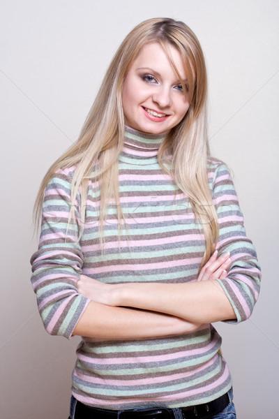 смеясь девушки свитер серый улыбка красоту Сток-фото © Lupen