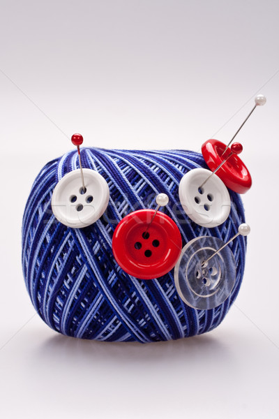 pins in wool ball with buttons Stock photo © Lupen