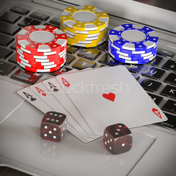 laptop with chips, dices and poker cards Stock photo © Lupen