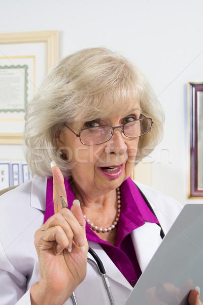 医師 警告 アドバイス 女性 医師 座って ストックフォト © LynneAlbright