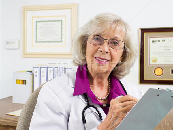 医師 質問 女性 座って デスク ストックフォト © LynneAlbright