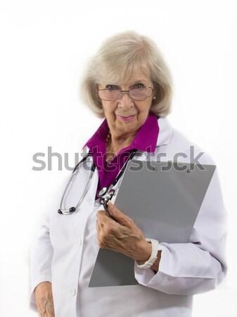 女性 医師 立って クリップボード 金属 ストックフォト © LynneAlbright