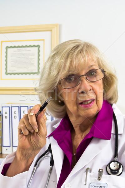 医師 警告 女性 座って デスク ストックフォト © LynneAlbright