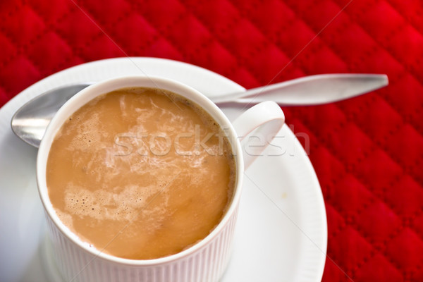 Coffee with Swirled Milk in a White Cup and Saucer Stock photo © LynneAlbright