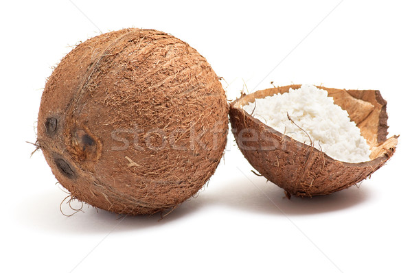 Whole and half part of coconut. Stock photo © lypnyk2