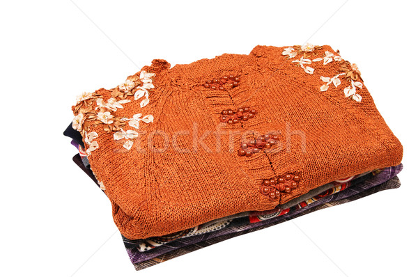 Stylish colorful sweaters and blouses on a white. Stock photo © lypnyk2
