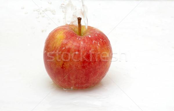 Water splash on an apple. Stock photo © lypnyk2
