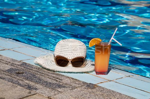 Eyewear,sunhat and tasty cocktail with lemon. Stock photo © lypnyk2