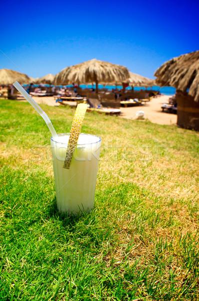 Pina Colada and sunny beach. Stock photo © lypnyk2
