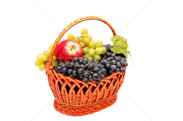 Bunches of grapes and apples in basket. Stock photo © lypnyk2