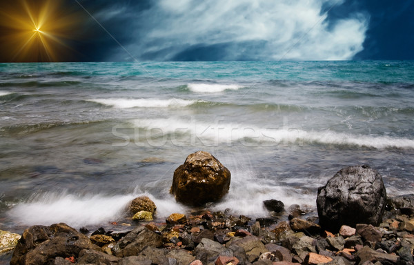 Sea foam and pebble in the water. Stock photo © lypnyk2