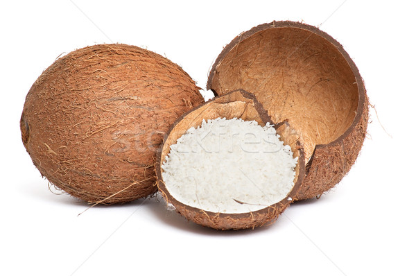 Whole and broken coconut on a white. Stock photo © lypnyk2