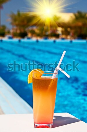 Glass of tasty juice with pipes. Stock photo © lypnyk2