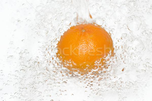 Friss tiszta víz csobbanás lédús narancs édesvíz Stock fotó © lypnyk2