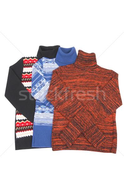 Three splendid colorful sweaters on a white. Stock photo © lypnyk2
