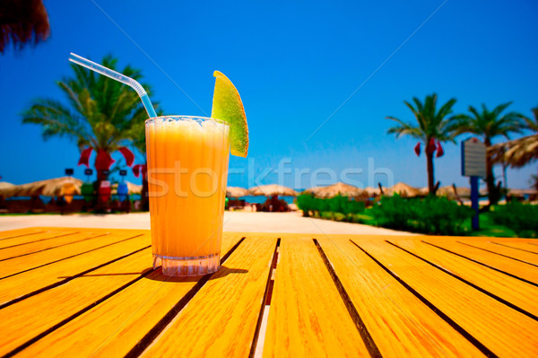 Tasty juice with melon opposite the beach Stock photo © lypnyk2