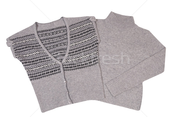 Modern warm waistcoat and sweater on a white. Stock photo © lypnyk2