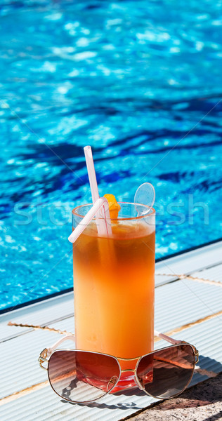 Glass of tasty juice with pipes and sunglasses. Stock photo © lypnyk2
