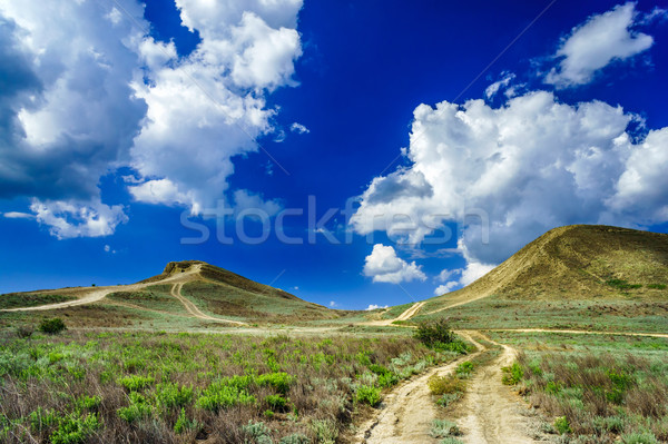 Fantastic hills and blue sky. Stock photo © lypnyk2