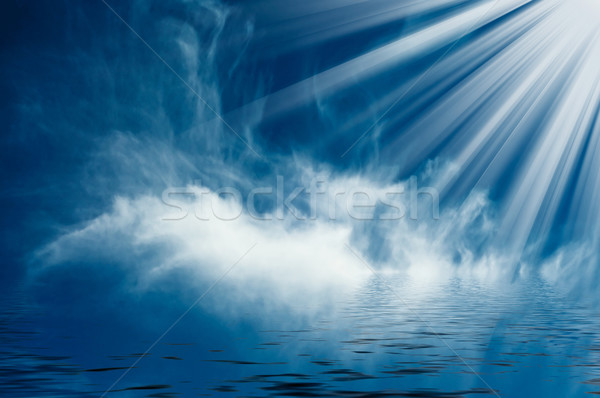Mooie zonnestralen boven zee blauwe hemel hemel Stockfoto © lypnyk2
