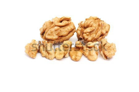 Pieces of walnuts on a white. Stock photo © lypnyk2