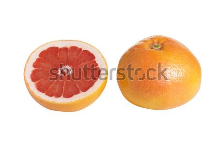 Whole and one piece of grapefruit on a white. Stock photo © lypnyk2