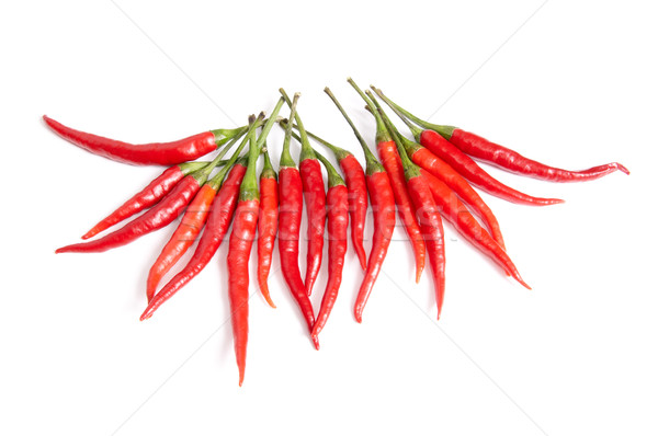 Nice,ripe peppers  on a white. Stock photo © lypnyk2