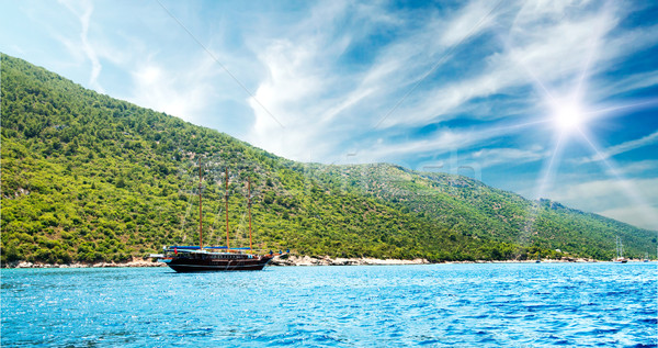 Bay in aegean sea and wooden yacht. Stock photo © lypnyk2