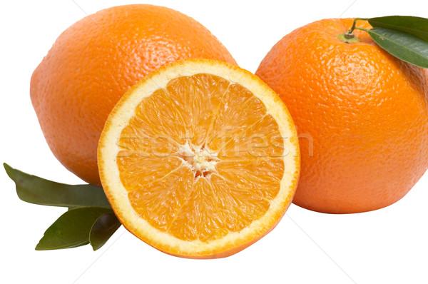 érett narancsok zöld levelek izolált fehér levél Stock fotó © lypnyk2