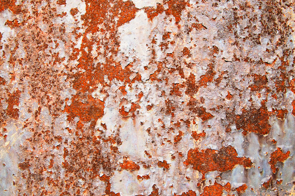 Oxidized metal sheet covered with old paint.  Stock photo © lypnyk2
