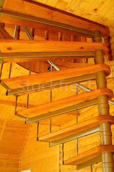 Spiral staircase in  the modern  wooden house. Stock photo © lypnyk2