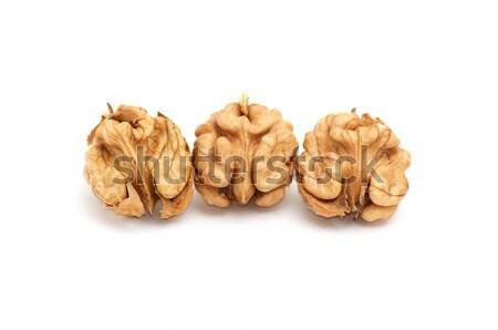 Kernels of walnuts on a white. Stock photo © lypnyk2