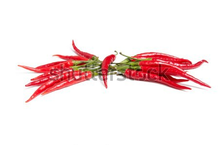 Splendid red peppers on a white. Stock photo © lypnyk2