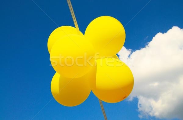 Blue sky,clouds and fun balls. Stock photo © lypnyk2
