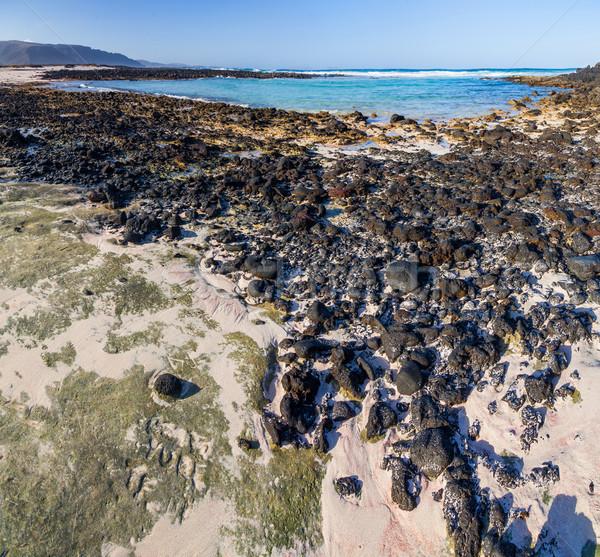 Strand vulkanisch stenen Spanje water Stockfoto © macsim