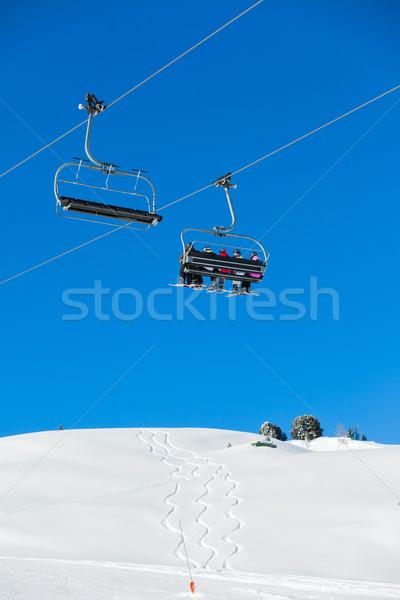 Skiers on a ski-lift Stock photo © macsim