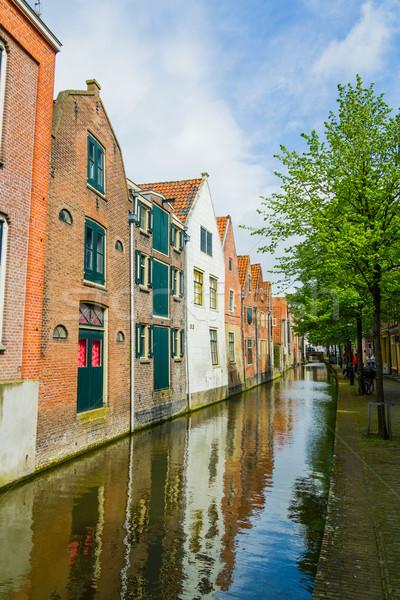 Typique maisons eau ensoleillée printemps Photo stock © macsim