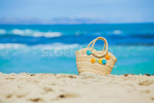 Photo paille fleurs exotique sable blanc Photo stock © macsim