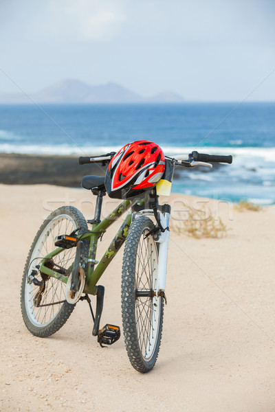 Bicycle with helmet, stand on the beach. Stock photo © macsim