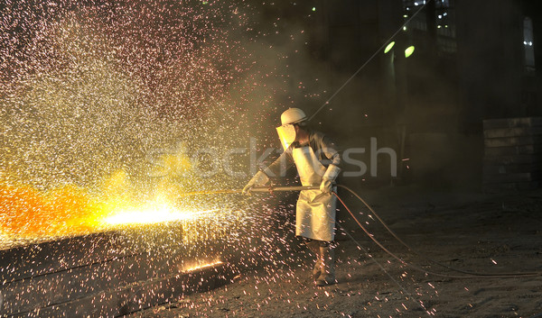 worker using torch cutter to cut through metal Stock photo © mady70
