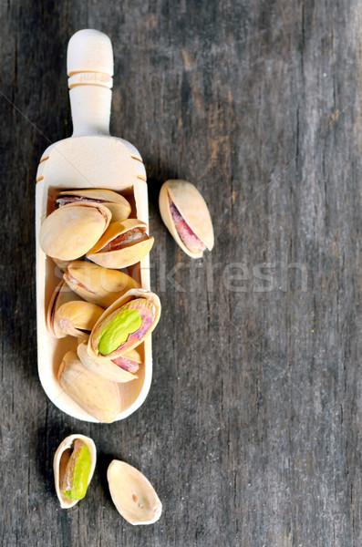 Kagyló fakanál nyers pisztácia diók öreg Stock fotó © mady70