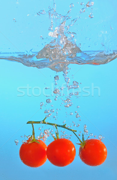 red tomatoes thrown into clear water Stock photo © mady70