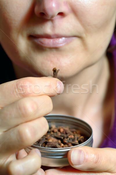 Woman chew dried clove spice Stock photo © mady70