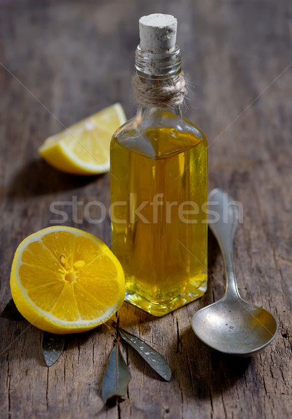 Olive oil and  lemon fruits on the wooden table Stock photo © mady70