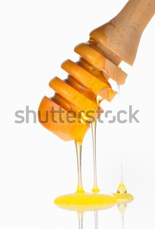 Honey dripping from a wooden honey dipper  Stock photo © mady70