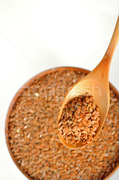 close up of flax seeds and wooden spoon Stock photo © mady70