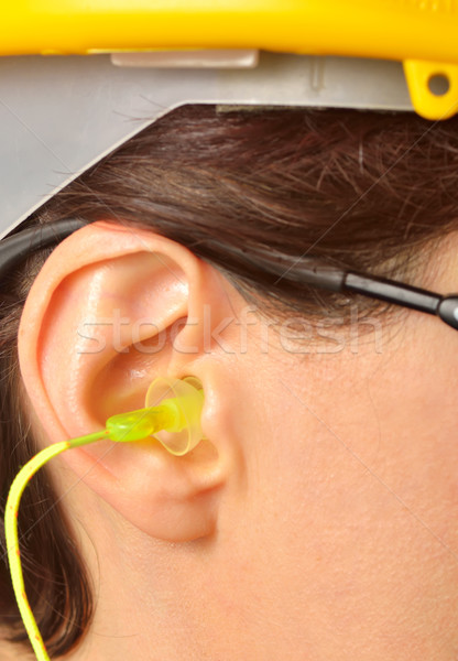 yellow earplug into the ear Stock photo © mady70