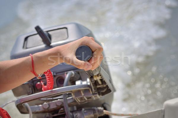 Fisherman hand and boat engine Stock photo © mady70